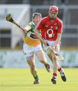 7 July 2012; Lorcan McLoughlin, Cork, in action against Sean Ryan, Offaly. GAA Hurling All-Ireland Senior Championship Phase 2, Cork v Offaly, Pairc Ui Chaoimh, Cork. Picture credit: Stephen McCarthy / SPORTSFILE
