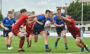 23 September 2017; Diarmuid Egan of Leinster is tackled by Ben Daly, left, and Evan Murphy of Munster during the under18 clubs interprovincial match between Leinster and Munster at Donnybrook Stadium in Dublin. Photo by Ramsey Cardy/Sportsfile