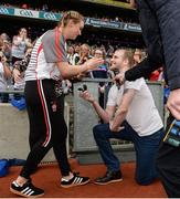 24 September 2017; Ryan McCloskey proposes to Derry's Ciara McGurk following the TG4 Ladies Football All-Ireland Junior Championship Final match between Derry and Fermanagh at Croke Park in Dublin. Photo by Cody Glenn/Sportsfile