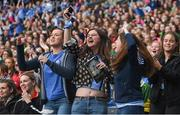 24 September 2017; Dublin supporters celebrate during the TG4 Ladies Football All-Ireland Senior Championship Final match between Dublin and Mayo at Croke Park in Dublin. Photo by Cody Glenn/Sportsfile