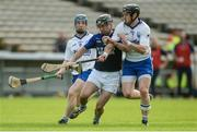 24 September 2017; Ronan O'Brien of Éire Óg Annacarty/Donohill in action against John Maher, left, and Stephen Lillis of Thurles Sarsfields during the Tipperary County Senior Club Hurling Championship semi-final match between Thurles Sarsfields and Éire Óg Annacarty/Donohill at Semple Stadium in Thurles, Tipperary. Photo by Piaras Ó Mídheach/Sportsfile