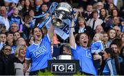 24 September 2017; Dublin players Denise McKenna, left, and Sinéad Finnegan and Ollie Kearney, age 2, son of team analyst Shane Kearney, celebrate with the Brendan Martin Cup after the TG4 Ladies Football All-Ireland Senior Championship Final match between Dublin and Mayo at Croke Park in Dublin. Photo by Brendan Moran/Sportsfile
