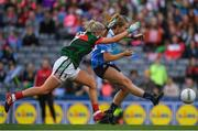 24 September 2017; Sarah McCaffrey of Dublin scores her side's second goal despite the best efforts of Fiona Doherty of Mayo during the TG4 Ladies Football All-Ireland Senior Championship Final match between Dublin and Mayo at Croke Park in Dublin. Photo by Brendan Moran/Sportsfile