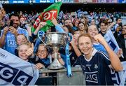 24 September 2017; Ciara Trant of Dublin celebrates with supporters and the Brendan Martin Cup following the TG4 Ladies Football All-Ireland Senior Championship Final match between Dublin and Mayo at Croke Park in Dublin. Photo by Cody Glenn/Sportsfile