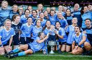 24 September 2017; Dublin players and Ollie Kearney, age 2, son of team analyst Shane Kearney celebrate with the Brendan Martin Cup following the TG4 Ladies Football All-Ireland Senior Championship Final match between Dublin and Mayo at Croke Park in Dublin. Photo by Cody Glenn/Sportsfile
