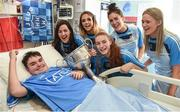 25 September 2017; Rory Whelan, age 14, from Fethard-on-Sea, Co Wexford, celebrates with the Brendan Martin Cup and Dublin Senior Ladies Footballers, from left, Lyndsey Davey, Rebecca McDonnell, Lauren Magee, Hannah O'Neill, and Emily Flanagan, in attendance during the All-Ireland Senior Ladies Football Champions visit to Temple Street Children's Hospital at Temple Street Children's Hospital, in Dublin. Photo by Cody Glenn/Sportsfile