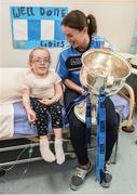 25 September 2017; Dublin Senior Ladies Football captain Sinéad Aherne brings the Brendan Martin Cup to the room of Grace Cogan, age 10, from Carrickmacross, Co Monaghan, in attendance during the All-Ireland Senior Ladies Football Champions visit to Temple Street Children's Hospital at Temple Street Children's Hospital, in Dublin. Photo by Cody Glenn/Sportsfile