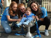 25 September 2017; Eoin McNeill, age 2, from Whitehall, Dublin, sits in the Brendan Martin Cup alongside Dublin Senior Ladies Footballers, from left, Ciara Trant, Lauren Magee, and Lyndsey Davey, in attendance during the All-Ireland Senior Ladies Football Champions visit to Temple Street Children's Hospital at Temple Street Children's Hospital, in Dublin. Photo by Cody Glenn/Sportsfile
