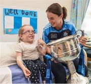 25 September 2017; Grace Cogan, age 10, from Carrickmarcross, Co Monaghan, holds the Brendan Martin Cup with Dublin Senior Ladies Football captain Sinéad Aherne in attendance during the All-Ireland Senior Ladies Football Champions visit to Temple Street Children's Hospital at Temple Street Children's Hospital, in Dublin. Photo by Cody Glenn/Sportsfile