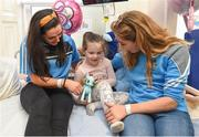 25 September 2017; Birthday girl Ava Finn, age 5, from Tubbercurry, Co Tipperary, celebrates her birthday with Dublin Senior Ladies Footballers Sinéad Goldrick and Sinéad Finnegan in attendance during the All-Ireland Senior Ladies Football Champions visit to Temple Street Children's Hospital at Temple Street Children's Hospital, in Dublin. Photo by Cody Glenn/Sportsfile
