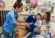 25 September 2017; Birthday girl Ava Finn, age 5, from Tubbercurry, Co Sligo, receives a Teddy bear from Dublin Senior Ladies Footballer Hannah O'Neill, sitting on the lap of his mother Aoife, in attendance during the All-Ireland Senior Ladies Football Champions visit to Temple Street Children's Hospital at Temple Street Children's Hospital, in Dublin. Photo by Cody Glenn/Sportsfile