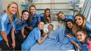 25 September 2017; Tommy Kavanagh, age 5, from Ballybough, Dublin, is visited by Dublin Senior Ladies Footballers, from left, Emily Flanagan, Olwen Carey, Sarah McCaffrey, Aoife Kane, Nicole Owens, Niamh Collins, Rebecca McDonnell, and Kate Sullivan, during the All-Ireland Senior Ladies Football Champions visit to Temple Street Children's Hospital at Temple Street Children's Hospital, in Dublin. Photo by Cody Glenn/Sportsfile