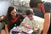 25 September 2017; Tristan Gannon, age 7, from Skerries, Co Dublin, reads with Mayo senior ladies footballers Doireann Hughes, left, and Martha Carter during the All-Ireland Senior Ladies Football Champions visit to Temple Street Children's Hospital at Temple Street Children's Hospital, in Dublin. Photo by Cody Glenn/Sportsfile