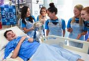 25 September 2017; Rory Whelan, age 14, from Fethard-on-Sea, Co Wexford, celebrates with the Brendan Martin Cup and Dublin senior ladies footballers, from left, Lyndsey Davey, Rebecca McDonnell, Hannah O'Neill, Emily Flanagan, and Lauren Magee during the All-Ireland Senior Ladies Football Champions visit to Temple Street Children's Hospital at Temple Street Children's Hospital, in Dublin. Photo by Cody Glenn/Sportsfile