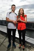 26 September 2017;  Marie Coady, Tax Partner PwC, presents Jamie Barron of Waterford with  his PwC GAA/GPA Player of the Month Award for August at a reception in PwC Offices, Dublin. Photo by Sam Barnes/Sportsfile