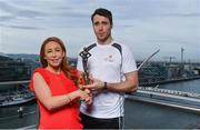26 September 2017; Marie Coady, Tax Partner PwC, presents Galway hurler Conor Cooney with his PwC GAA/GPA Player of the Month Award for July at a reception in PwC Offices, Dublin. Photo by Sam Barnes/Sportsfile