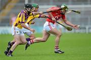 14 July 2012; Niall McCarthy, Cork, in action against Darren Stamp and Keith Rossiter, Wexford. GAA Hurling All-Ireland Senior Championship, Phase 3, Wexford v Cork, Semple Stadium, Thurles, Co. Tipperary. Picture credit: Matt Browne / SPORTSFILE