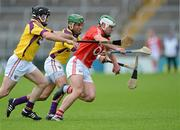 14 July 2012; Niall McCarthy, Cork, in action against Keith Rossiter and Darren Stamp, Wexford. GAA Hurling All-Ireland Senior Championship, Phase 3, Wexford v Cork, Semple Stadium, Thurles, Co. Tipperary. Picture credit: Matt Browne / SPORTSFILE