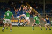14 July 2012; Longford players Niall Mulligan and Mickey Quinn challenge Limerick's Eoghan O'Connor. GAA Football All-Ireland Senior Championship Qualifier, Round 2, Longford v Limerick, Glennon Brothers Pearse Park, Longford. Picture credit: Ray McManus / SPORTSFILE