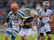 15 July 2012; Keith O'Sullivan, Cappoquin NS, Waterford, in action against Niall Hoctor, St. Mary's Clonmel, Tipperary, during the Primary Go-games. Munster GAA Hurling Senior Championship Final, Waterford v Tipperary, Pairc Ui Chaoimh, Cork. Picture credit: Stephen McCarthy / SPORTSFILE