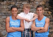 16 July 2012; ElectricIreland, proud sponsors of TeamIreland,link up with Robert and Marian Heffernan to look forward to the London 2012 Olympic Games. Rob Heffernan competes in the 20km walk on August 4thand the 50km walk on August 11th, whileMarianbegins her event, the 4X400m relay on August 10th. Pictured with Rob and Marian Heffernan is their son Cathal, age 7. Ely Place, Dublin. Picture credit: David Maher / SPORTSFILE