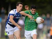 21 July 2012; Emlyn Mulligan, Leitrim, in action against John O'Loughlin, Laois. GAA Football All-Ireland Senior Championship Qualifier, Round 3, Leitrim v Laois, Sean McDermott Park, Carrick-on-Shannon, Co. Leitrim. Picture credit: David Maher / SPORTSFILE