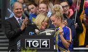 24 September 2017; Tipperary captain Samantha Lambert os presented with the Mary Quinn Memorial Cup by Maire Hickey, President, LFGA, after the TG4 Ladies Football All-Ireland Intermediate Championship Final match between Tipperary and Tyrone at Croke Park in Dublin. Photo by Brendan Moran/Sportsfile