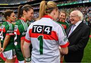 24 September 2017; President of Ireland Michael D. Higgins is introduced to Yvonne Byrne and Orla Conlon of Mayo by captain Sarah Tierney prior to the TG4 Ladies Football All-Ireland Senior Championship Final match between Dublin and Mayo at Croke Park in Dublin. Photo by Brendan Moran/Sportsfile