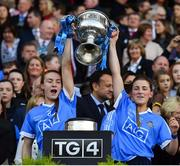 24 September 2017; Lauren Magee, left, and Aoife Kane of Dublin lift the Brendan Martin Cup after the TG4 Ladies Football All-Ireland Senior Championship Final match between Dublin and Mayo at Croke Park in Dublin. Photo by Brendan Moran/Sportsfile