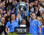 24 September 2017; Leah Caffrey, left, and Sarah McCaffrey of Dublin lift the Brendan Martin Cup after the TG4 Ladies Football All-Ireland Senior Championship Final match between Dublin and Mayo at Croke Park in Dublin. Photo by Brendan Moran/Sportsfile