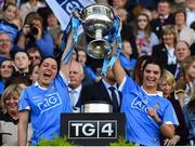 24 September 2017; Sinéad Goldrick, left, and Niamh Collins of Dublin lift the Brendan Martin Cup after the TG4 Ladies Football All-Ireland Senior Championship Final match between Dublin and Mayo at Croke Park in Dublin. Photo by Brendan Moran/Sportsfile