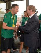 27 July 2012; An Taoiseach Enda Kenny, T.D., greets Irish team physio Ger Hartmann while visiting Irish athletes at their training base in St. Mary's University College ahead of the London 2012 Olympic Games. Teddington, Middlesex, London, England. Picture credit: Brendan Moran / SPORTSFILE