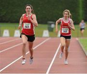 28 July 2012; Niamh Markham, left, Ennis Track A.C., Co. Clare, leads second placed finisher Jessica Coyne, right, Dooneen A.C., Co. Limerick, on her way to winning the Girl's Under-18 1500m event. Woodie's DIY Juvenile Track and Field Championships of Ireland, Tullamore Harriers Stadium, Tullamore, Co. Offaly. Picture credit: Tomas Greally / SPORTSFILE