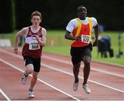 28 July 2012; Mervyn Harris, left, Mullingar Harriers A.C., Co. Westmeath, and eventual third place finisher Epey Clincy, Tallaght A.C., Co. Dublin, in action during the Boy's Under-16 200m event. Woodie's DIY Juvenile Track and Field Championships of Ireland, Tullamore Harriers Stadium, Tullamore, Co. Offaly. Picture credit: Tomas Greally / SPORTSFILE