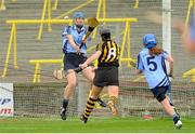 28 July 2012; Katie Power, Kilkenny, scores her side's second goal of the game despite the attention of Dublin's Fiona Hayes, left, and Arlene Cushen, 5. All-Ireland Senior Camogie Championship, Quarter-Final Qualifier, Dublin v Kilkenny, O'Moore Park, Portlaoise, Co. Laois. Picture credit: Pat Murphy / SPORTSFILE