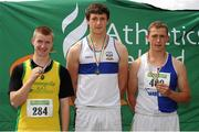 28 July 2012; Winner of the Boy's Under-18 Discus event Michael Hanlon, Dunboyne A.C., Co. Meath, centre, with second placed Andrew Mc Carthy, Gneeveguilla A.C., Co. Kerry, left, and third placed James Mulligan,  Tullamore Harriers A.C., Co. Offaly. Woodie's DIY Juvenile Track and Field Championships of Ireland, Tullamore Harriers Stadium, Tullamore, Co. Offaly. Picture credit: Tomas Greally / SPORTSFILE