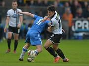 7 October 2017; Jamie McGrath of Dundalk in action against Tommy McBride of Finn Harps  during the SSE Airtricity League Premier Division match between Finn Harps and Dundalk at Finn Park in Ballybofey, Co Donegal. Photo by Oliver McVeigh/Sportsfile