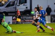 7 October 2017; Jamie McGrath of Dundalk scoring his side's second goal in injury time past Ciaran Gallagher of Finn Harps  during the SSE Airtricity League Premier Division match between Finn Harps and Dundalk at Finn Park in Ballybofey, Co Donegal. Photo by Oliver McVeigh/Sportsfile