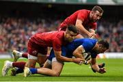 7 October 2017; Robbie Henshaw of Leinster is tackled by Conor Murray and JJ Hanrahan of Munster during the Guinness PRO14 Round 6 match between Leinster and Munster at the Aviva Stadium in Dublin. Photo by Brendan Moran/Sportsfile