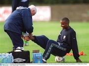 14 October 2002; Republic of Ireland's Clinton Morrison receives treatment from team physio Mick Byrne during squad training. John Hyland Park, Baldonnel, Co. Dublin. Soccer. Picture credit; Damien Eagers / SPORTSFILE