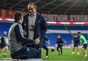 8 October 2017; Republic of Ireland manager Martin O'Neill and Seamus Coleman react to the Scotland v Slovenia qualifer scoreline during squad training at Cardiff City Stadium in Cardiff, Wales. Photo by Stephen McCarthy/Sportsfile