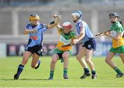 4 August 2012; Siobhan Flanery, Offaly, in action against Laura Twomey and Catriona Power, Dublin. All-Ireland Senior Camogie Championship Quarter-Final, Dublin v Offaly, Parnell Park, Dublin. Picture credit: Ray Lohan / SPORTSFILE