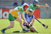 4 August 2012; Laura Twomey, Dublin, in action against Siobhan Flannery, left, and Fiona Stephens, Offaly. All-Ireland Senior Camogie Championship Quarter-Final, Dublin v Offaly, Parnell Park, Dublin. Picture credit: Ray Lohan / SPORTSFILE
