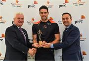 12 October 2017; Dublin's James McCarthy and Galway's Gearóid McInerney have been confirmed as the PwC GAA/GPA Players of the Month for September in football and hurling. Pictured is Galway hurler Gearoid McInerney being presented with his PwC GAA/GPA Player of the Month for September by David McGee, right, and Markets and Strategy Partner, PwC, and Uachtarán Chumann Lúthchleas Gael Aogán Ó Fearghail at the PwC offices in Spencer Dock, Dublin. Photo by Brendan Moran/Sportsfile