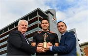 12 October 2017; Dublin's James McCarthy and Galway's Gearóid McInerney have been confirmed as the PwC GAA/GPA Players of the Month for September in football and hurling. Pictured is Galway hurler Gearoid McInerney being presented with his PwC GAA/GPA Player of the Month for September by David McGee, right, and Markets and Strategy Partner, PwC and Uachtarán Chumann Lúthchleas Gael Aogán Ó Fearghail at the PwC offices in Spencer Dock, Dublin. Photo by Brendan Moran/Sportsfile