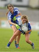 6 August 2012; Orla O'Neill, Roscommon, in action against Emer Hillery, Clare. Both teams wore provincial colours due to a colour clash, Clare, blue, and Roscommon, white. All-Ireland Ladies Football Minor B Championship Final, Clare v Roscommon, St. Brendan's Park, Birr, Co. Offaly. Picture credit: Pat Murphy / SPORTSFILE