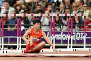 7 August 2012; China's Xiang Liu sits on the track after falling at the first hurdle during the heats of the Men's 110m hurdles. London 2012 Olympic Games, Athletics, Olympic Stadium, Olympic Park, Stratford, London, England. Picture credit: Brendan Moran / SPORTSFILE