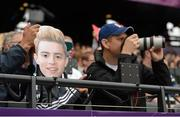 7 August 2012; A Jedward mask is seen in the crowd during the morning session of the athletics. London 2012 Olympic Games, Athletics, Olympic Stadium, Olympic Park, Stratford, London, England. Picture credit: Brendan Moran / SPORTSFILE