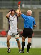 14 October 2017; Ross O'Carroll of Kilmacud Crokes reacts after being shown the red card by referee Dave Feeney for a tackle on James McCarthy of Ballymun Kickhams during the Dublin County Senior Football Championship Semi-Final match between Ballymun Kickhams and Kilmacud Crokes at Parnell Park in Dublin. Photo by Piaras Ó Mídheach/Sportsfile