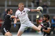15 October 2017; Francis McEldowney of Slaughtneil in action against Aidan Branagan, left, and Niall Branagan of Kilcoo during the AIB Ulster GAA Football Senior Club Championship First Round match between Kilcoo and Slaughtneil at Páirc Esler in Down. Photo by Seb Daly/Sportsfile